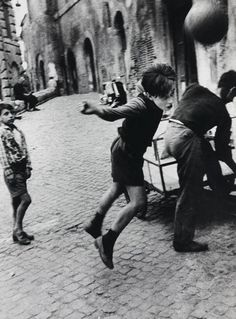 This is a photograph by William Klein. He is best known for his street photography. He was also known for not being afraid of getting up close and personal with his photographs and he was often offensive. http://pinterest.com/pin/114841859219494672/