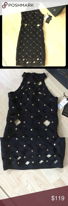 Bebe Dress This Bebe Bandage caged dress is guaranteed to turn heads. Worn only once, I have the original tags. It fits true to size and has lots of stretch in it. It's very comfortable to wear. Has gold detailing. Is in perfect like new condition. bebe Dresses Mini