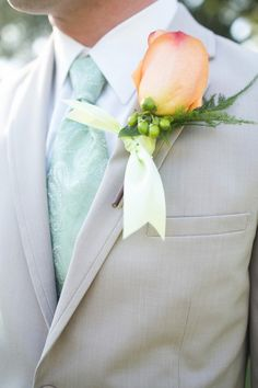 Cranberry tie, gray suit, peach flower ||| A South Carolina Peach and Mint Wedding