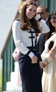 17/06/2014..Breezy: Despite the sunshine, the Duchess' hair almost fell foul of a gust of wind