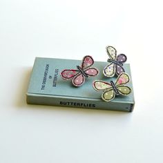 Handmade embroidered textile butterfly brooches by Stitch Galore