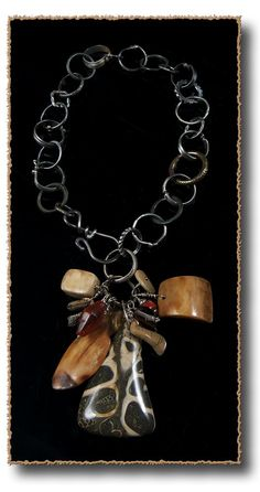 AllisonBellowsJewelry.com   Sterling Silver, Ancient Fossils, Ancient Fossil Walrus Ivory, Ancient Carnelian, Ancient Coral, Citrine, Ancient Celtic Money Ring, Antique Brass African Ring.
