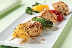 Pineapple, peppers and chicken basted in a balsamic vinaigrette make for kebabs with big summer flavor—and low-fat, low-sodium, low-calorie deliciousness.