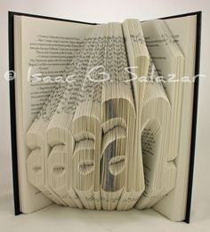 Isaac G. Salazar's work is a thing of beauty, carving new words out of old books. He sometimes sells his works on Etsy. As for why books, he explai. Folded Book Art, Book Folding, Book Sculpture, Sculptures, Used Books, My Books, Book Crafts, Paper Crafts, Recycled Art