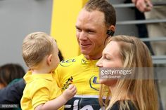 Chris Froome of Great Britain and Team Sky with his son Kellan and wife Michelle on the podium after winning the yellow jersey during stage twenty...