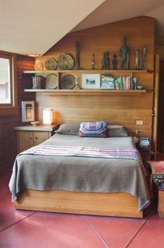 """Located at the end of the front gallery hall, the master bedroom opens up with vaulted ceilings and ample sunlight.  Wright's John J. Dobkins House, Canton Illinois - A """"Usonian"""" home designed using a triangular grid."""