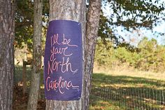 I had the idea to line our Tree aisle with one of Our Favorite songs 'Honey Bee' By Blake Shelton, we cut canvas and used our wedding colors! (We edited a few of the lyrics to fit us as well!)  Photo from Rebekah & Trevor collection by Gruen Photo & Design
