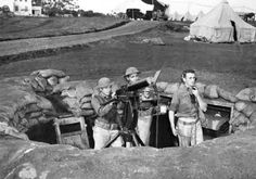 Troops man a machine gun nest at Wheeler Field against the incoming bombers.