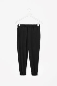 ELASTIC WAIST TROUSERS  A loose, relaxed fit, these lightweight wool trousers have a gathered elastic waistband and cuffs. Designed to sit on the hips, they have a slightly dropped crotch and two welt front pockets.