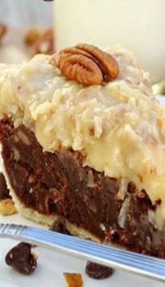 German chocolate cake fudge-like pie, topped with classic homemade coconut pecan frosting. The chocolate filling is loaded with semi-sweet chocolate chips and pecans, and tastes a lot like a dense, chewy brownie. It was hard … Chocolate Fudge Pie, German Chocolate Pies, Chocolate Desserts, Chocolate Filling, Chocolate Frosting, Decadent Chocolate, Coconut Chocolate, Fudge Cake, Fudge Brownie Pie