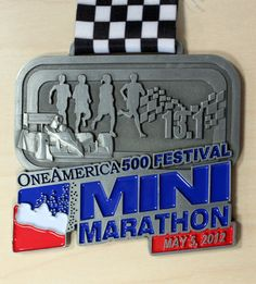 Cheered for friends and family at the Indy Mini-Marathon 2012. They finished on a very hot day. Congrats!