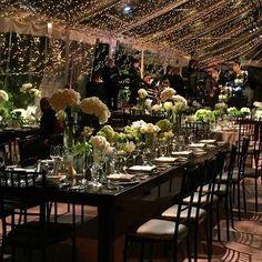 Elegant black and white tented wedding decor