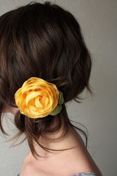 Flower in messy side bun. Pretty.