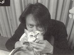 He looks so happy with his cat