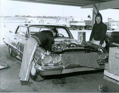 Ken Miller and James Hylton (R) work on Rex White's Chevy prior to the 1963 Daytona 500...
