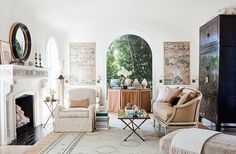 """The wallpaper panels that flank the arched window inspired the overall design of the serene living room. """"I love the pattern of these Gracie wallpaper panels.They really set the palette for the room,"""" Mark says."""