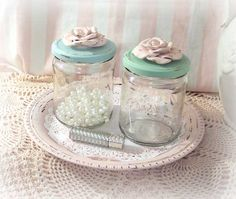 shabby chic jar with painted shades of blue lids
