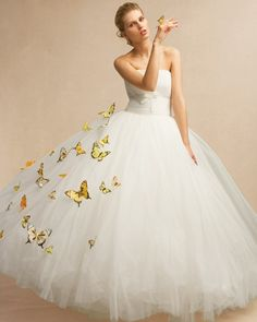 """A billowing cloud of tulle is an irresistible spot for a flock of """"papillons"""" -- wired loosely to the fabric -- to rest their delicate wings."""