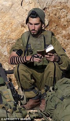 IDF soldier wrapped in Teffillin. Can't get enough of these pictures <3  Stand by Israel!!!