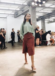 Creatures of Comfort Spring/Summer 2016. Pistachio jumper, red wrap knee length skirt, nude strappy sandal heels