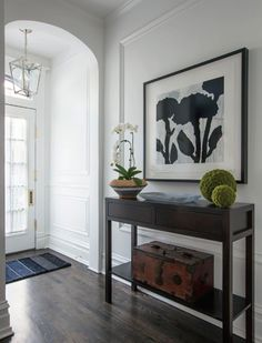 Arched entry way with all white wainscoting on entire wall | Alexandra Kaehler