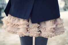 love the contrast of ruffles with a tailored jacket
