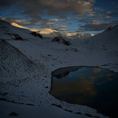 Last light of the day while coming down south from Mighty Baralacha Pass in Himachal Pradesh India. This small Lake is called Suraj Taal. I never expected snowfall in September.  For group tour in 2016 with me! panghal@hotmail.com