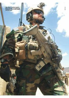 A Fitzy-looking guy carrying a SCAR-L rifle. Fitz usually carried the larger-caliber version, the SCAR-H, on his Afghan tour. Military Photos, Military Weapons, Military Life, Military Art, Tactical Beard, Tactical Armor, Marsoc Marines, Marine Raiders, Fn Scar