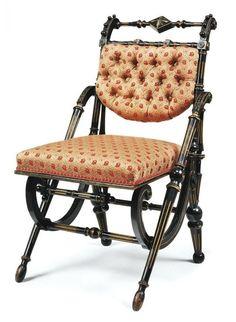 Victorian Hunzinger parcel gilt ebonized chair, c.1869.