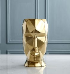 Stylish Geometric Human Face VaseAlmost a work of art in itself, this Stylish Geometric Human Face Vase will finish off your flower or plant arrangement with aplomb.    Its strong, chiselled features are showcased in porcelain white or ceramic gold. Paired together in the same colour or both colours but in differing sizes will make such a visual impact in your home.    These stunning pieces are substantial in size. The smallest size is 19cm wide x 27cm high and the largest standing proud at… Ceramic Plant Pots, Ceramic Vase, Metal Flowers, Nordic Style, Home Interior, Glass Vase, Candle Holders, Bronze, Colours