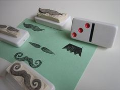 hand-carved rubber mustache stamps mounted on repurposed dominoes