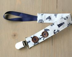 Items similar to Boy pacifier clip, navy nautical pacifier holder, button pacifier clip, baby boy gift, baby shower gift on Etsy Boy Pacifier, Pacifier Holder, Pacifier Clips, Baby Boy Gifts, Girl Gifts, Baby Shower Gifts, Nautical Baby, Trendy Baby, Baby Accessories
