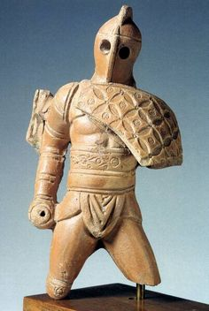 This small terracotta statue from the first century AD represents a thraex, a type of gladiator armed with a short sword (broken off) and a short shield, protecting only his chest.