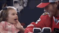 Duncan made sure his new teammate had the proper equipment before hitting the ice. | This Little Girl Is Unable To Walk, But She Just Scored A Goal For The Chicago Blackhawks, Love this  so much.