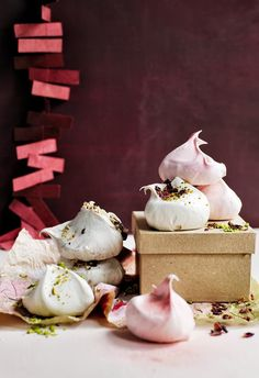 Meringue kisses: Make a present of pretty meringue kisses by nestling them in a box lined with tissue paper. | 6 Christmas food presents to gift in 2018 | Styling: Steve Pearce | Photographer: Chris Court