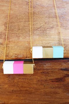 DIY -->A little paint and some common jewelry findings transform these craft-store wooden blocks into a necklace!