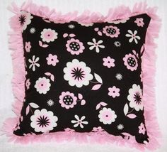 Pink and black floral children's pillow with pink fringe