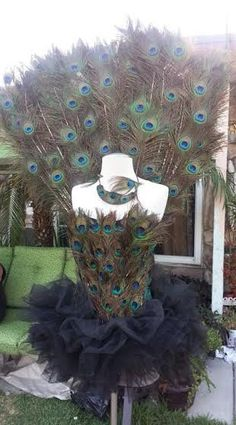This costume is handmade to order. -The tail feather (slides in easily in and out of the back of the corset). The tail feather has the eyes