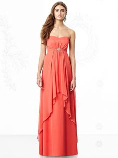 Strapless dress in lux chiffon has high-low overskirt and sparkling brooch at empire waist. Pleated detail graces the back.