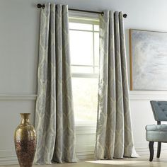 """Our Reese blackout curtain features a stunning medallion pattern and hangs easily with grommet-top construction. Since it's a """"blackout"""" curtain, its lining blocks light and provides noise reduction making it a perfect choice for a bedroom—and daytime nappers. Not only is it stylish and functional, it's easy care, too."""