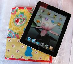 iPad slip cover with wrap around pockettutorial - How to make.  The magnet system on the new iPad has been slightly changed, which results in many Smart Covers and similar cases not to work, so measure and make your own.