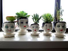 Doll head planters | photo by jeannette ordas (so funny to see my planters, my old windowsill & my photo on pinterest!!)