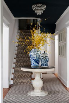 Glorious Pedestal Foyer Table Entry Traditional with Stair Runner Blue and White. Glorious Pedestal Foyer Table Entry Traditional with Stair Runner Blue and White Ceramic Vase Black
