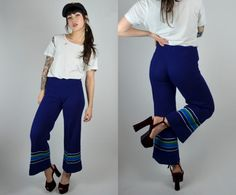 Awesome 1960s I.Magnin Flares! Done in a navy blue 100% acrylic knit. High waist fit with an elastic waistband. Cropped flared legs with a 3 inseam. Unlined. Circa; 1963 ♥  Size: XS Tag: -- Brand: Piccolino for I.Magnin Very Good Vintage Condition: Minor all over pilling, minor wear around hems.  Measurements: Waist: 22 - 28 Hips: 34 - 40 Rise: 10 Inseam: 27  Brook-Lynnes Measurements; bust: 28 waist: 25 hips:32 Height: 5 1  4O16IMAGNIN  *Any overpayment exceeding $4 USD will be refunded…