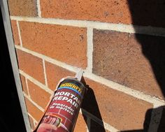 Before painting brick or stucco you need to clean the surface and fill any cracks or holes.