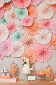 A cluster of pretty paper pinwheels makes a gorgeous backdrop for any celebration - a wedding, shower, engagement party or even a rehearsal dinner!that cake is gorgeous too.idea for a styled wedding shoot Diy Party Dekoration, Decoration Evenementielle, Party Wall Decorations, Pinwheel Decorations, Paper Wedding Decorations, Tissue Paper Decorations, Paper Fans Wedding, Umbrella Decorations, Easy Decorations