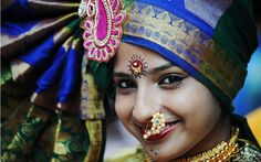An Indian girl wearing traditional jewellery takes part in a procession celebrating 'Gudi Padwa' or the Maharashtrian new year in Mumbai. Gu...