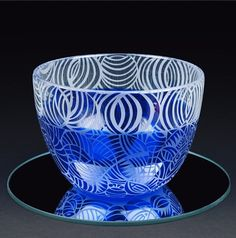 Hand blown glass bowl by David Wilson and etched by Loretta Forde. One of a kind display piece and yet fully functional. David & Loretta have their glass on display in museums throughout the world and are memberships of the highly acclaimed Southern Highland Craft Guild. Their glass is created from their off the grid home in the Blue Ridge Mountains. Each piece is carefully crafted. This piece has rich blues and cleat etching. 9 wide 6 1/4 high