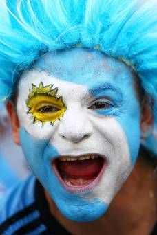 BELO HORIZONTE, BRAZIL - JUNE 21:  An Argentina fan enjoys the atmosphere prior to the 2014 FIFA World Cup Brazil Group F match between Argentina and Iran at Estadio Mineirao on June 21, 2014 in Belo Horizonte, Brazil.  (Photo by Paul Gilham/Getty Images)