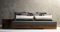 Patone Sofa.  This new sofa features dual shelf units (side and back) made from your choice of exotic wood that double as an arm and console.  Natural rosewood as shown.